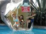 The three ladies terrified in the jaws of death.  (Or just playing around on the Paradise dragon water-slide.)