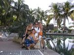 Three reasons why you should quit your job, buy a boat, and sail to Mexico like Greg did.  Kristi, Jean and Cherie surround him by the pool at Paradise Village, Puerta Vallarta, Mexico.