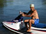 "Eddy with the classic ""Coors"" hat, on a jet ski.  Which is older, the ""Coors"" hat, or the jet ski?  You decide."