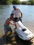 Jeff Beu and Dustin Fox with a jet ski.