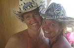 Jean and Cherie in their signature animal print cowboy hats.