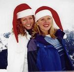 "Being borm and raised in California, I had never really celebrated ""Christmas"" in the snow.  Kristi and I in our Santa hats."