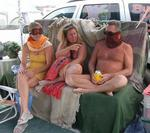 Waiting out the sandstorm.  Jean with her ski goggles, Anne with her sarong, and Rennie with his well placed beer.