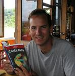 "Greg reading the Lonely Planet ""Costa Rica"" guidebook."