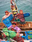 Three canoes full of native women and their colorful art.  More canoes arrive every minute!!