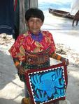 "A Kuna Yala displaying one of her ""molas.""  They take pride in their art which is sought after all over the globe."