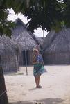 Anne with the Kuna thatched-huts.