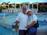John and Marsha in front of the pool.