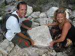 Cherie and Greg with rocks written on by 19th century ship-wrecked sailors.