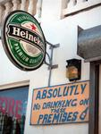 "A beer sign next to a ""no drinking"" sign.  What next?"
