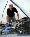 Greg examines the engine of his 400 HP Nissan 300ZX.