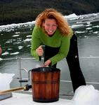 With an ice-pick, Cherie breaks apart the glacial ice and puts it into the traditional ice-cream maker.