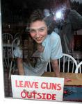 "Dana asks her customers to please ""Leave Guns Outside."""