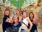 Four big Flirts.  Cherie, Carter, Kristi and Renee with bags of Flirts, a typical South African snack.