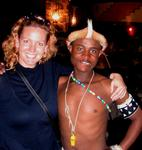 Cherie with a Zulu dancer (whistle not customary Zulu attire.)
