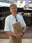 Tinus isn't too proud to carry a bottle-cap purse.