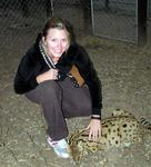 Kristi plays with the cuddly serval.  It may look like a cat, but it doesn't feel like one.