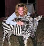 Cherie bonds with a baby zebra.
