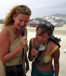 Cherie and Grace serenade nearby camps during a sandstorm.