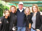 Four ladies with Brian, Predator II's captain.