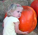 I think Grace wants this pumpkin!