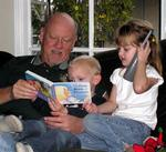 """Grandpa"" reads a book to Tanner while Ellie chats on the phone.  (There is so much to say when you are 4-years-old!)"