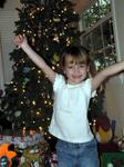 Ellie jumps for joy at all the Christmas gifts she got!