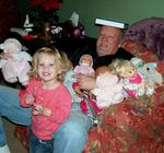 Dad, surrounded by dolls. *Photo by Joanne.
