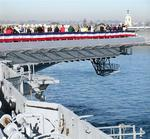 Everyone gathers on the flight deck to watch the Midway twist around San Diego Bay.
