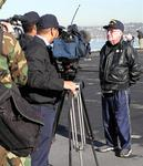 News crews cover the historic event.  Midway will be the nations largest aircraft-carrier museum.