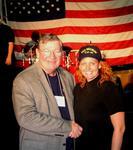 "Cherie shakes hands with Congressman Randy ""Duke"" Cunningham."