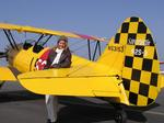 Cherie spends the day buzzing around LA, flying a 1940 Stearman with pilot Gabe Lopez. *Photo by Norm