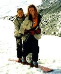 Cherie and Kristi on a tandem snowboard in Austria.  This photo was taken before I snapped my arm in two.