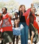 Cherie doing the Sibhaca dance with the Swazis in Swaziland. *Photo by Renee.
