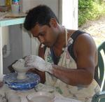 A local artist makes pottery.