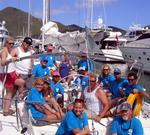 "The rotating crew of ""BVI Yacht Charters 1"" (winner of the Columbus Cup) for the Heineken Regatta 2004."