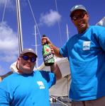 Co-captains Mark and Phil celebrate their win with an extra-large bottle of Heineken.
