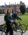 Cherie and Enrico ride past the Muckross house, Killarney.