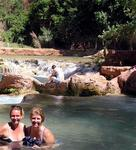 Cherie and Jean kick off their hiking gear and take a dip in the cool pristine waters.