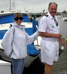 American Legion Yacht Club's John Hamilton leads Kim down the dock at the 15th Annual Sail for the Blind and Visually Impaired.