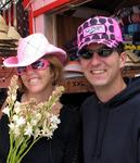 Jean and Greg in cool pink hats.