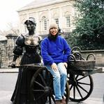 Renee takes a ride on Molly Malone's cart.