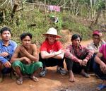 Cherie hanging out with some of the men from the Karen hill-tribe in Northern Thailand.