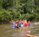 We had to use bamboo rafts to get from one village to the next while trekking in the hill-tribes. *Photo by Yorham.