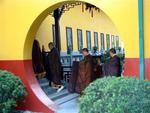 Monks walk into the temple.