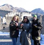 Scott and Cherie drinking red wine on the Great Wall with a Chinese guard named Wow.