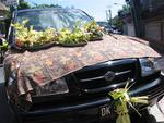 A car covered with offerings for Shiva.