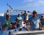 A happy crew charters its yachts from BVI Yacht Charters.