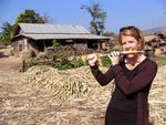 Jean (who used to play the flute) tries her hand at playing sugar-cane.