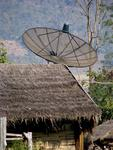 A satellite-dish on a shack.